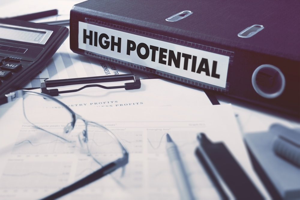 High Potential - Ring Binder on Office Desktop with Office Supplies. Business Concept on Blurred Background. Toned Illustration.