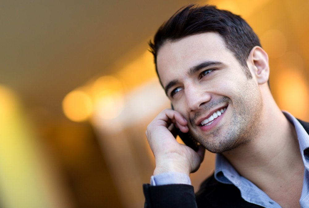 Successful businessman talking on her cell phone